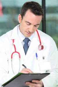 Doctor taking notes in notebook