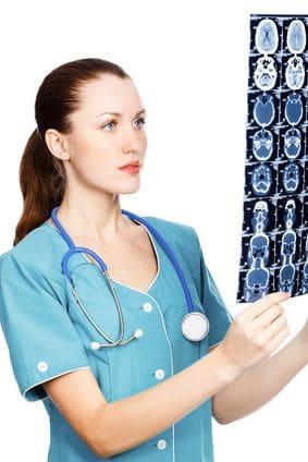 Female doctor reviews brain MRI