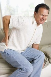 Man holding his back in serious pain