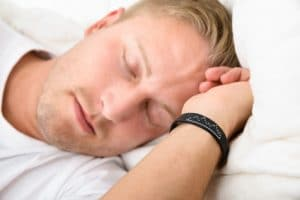 Young man with sleep apnea resting in his bed